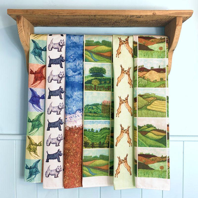 Tea towels of Troy's original art work.