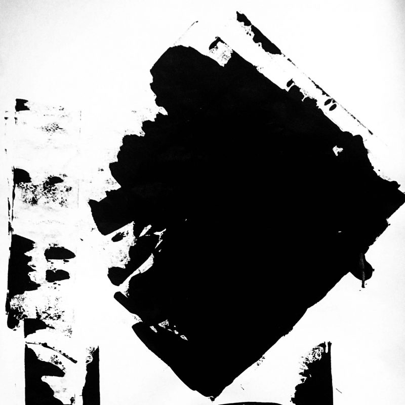 Black acrylic paint applied to paper using an abstract process to create large blocks of black on white