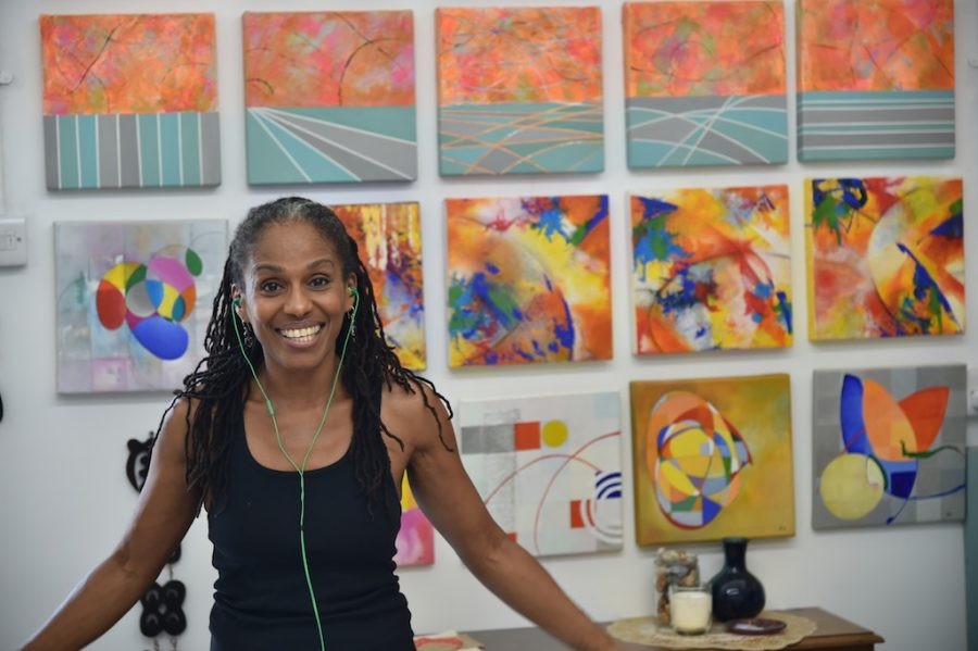 The Artist Carla Armour takes a break next to her 'Wall of Smalls' to pose for the visiting photographer.