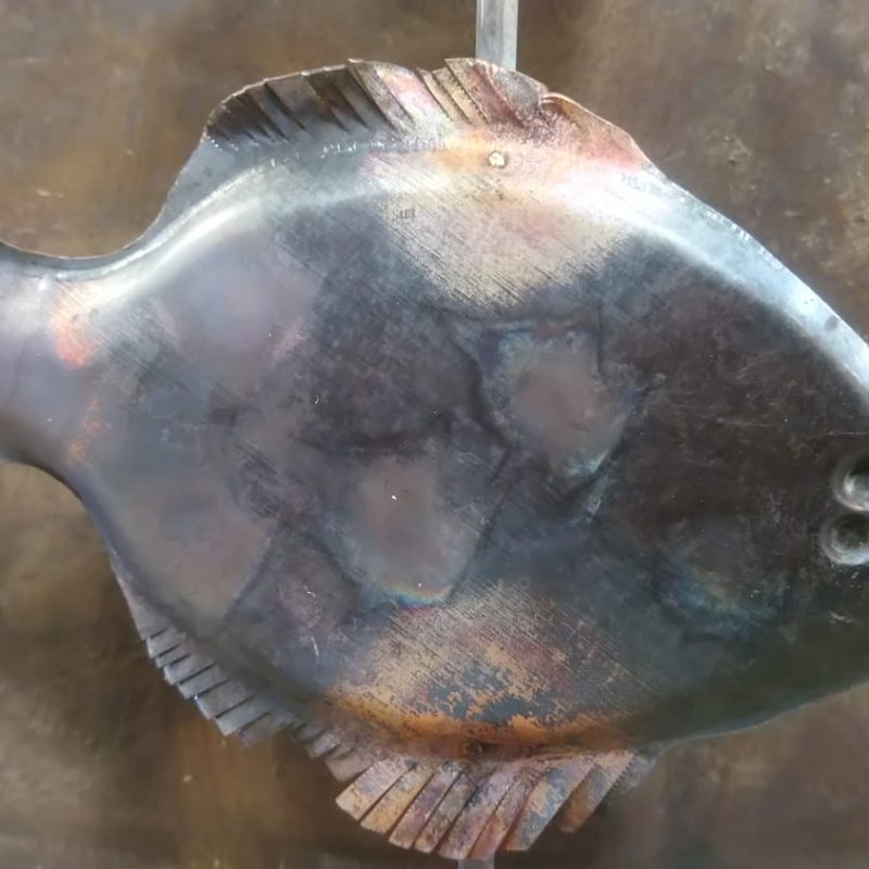 A metal sculpture of a fish