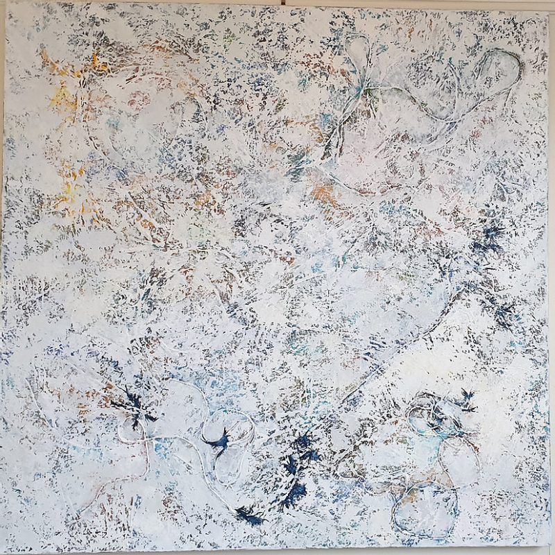An abstract piece, layers of blue, gold and white acrylic pain as well as hessian threads.