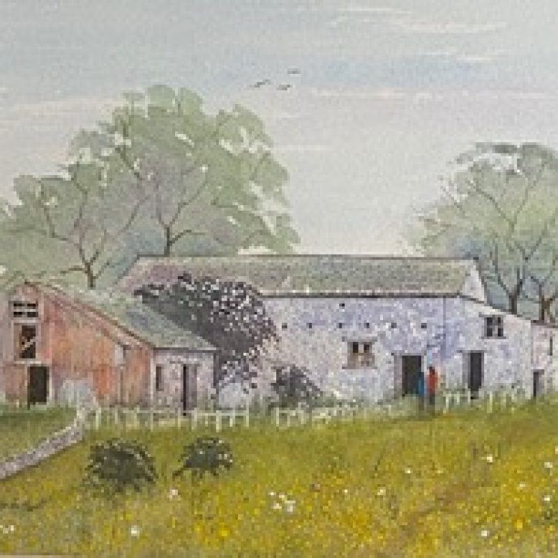Barns, trees and meadows in an idyllic setting of Yorkshire Dales.