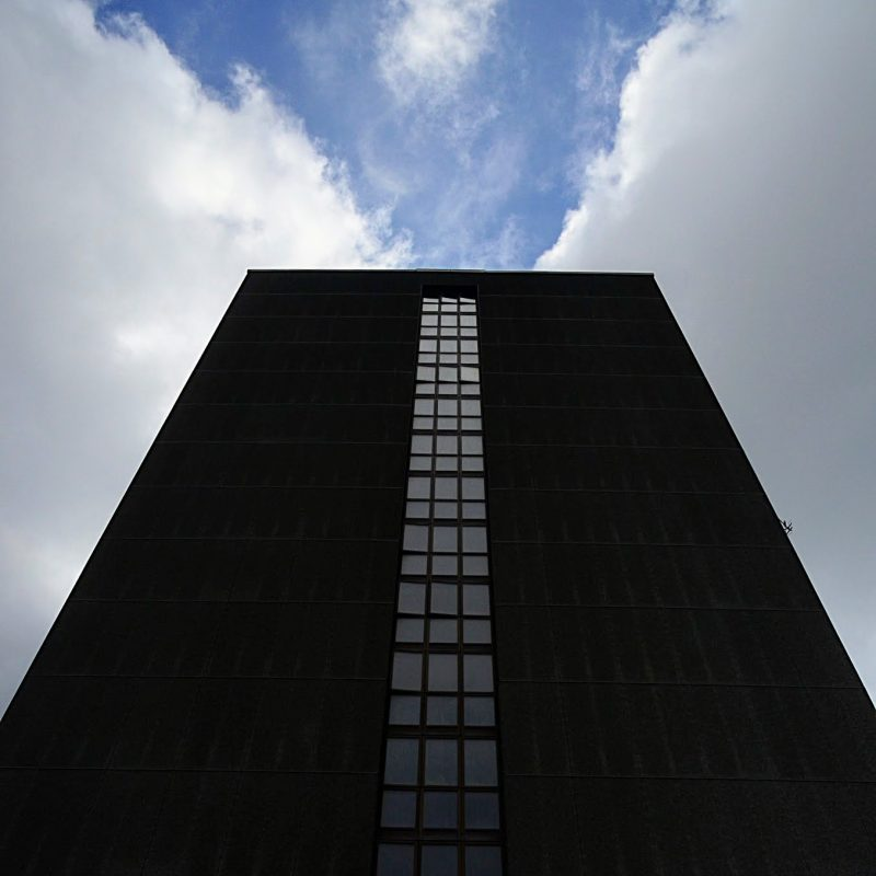 A perspective of a building and the sky