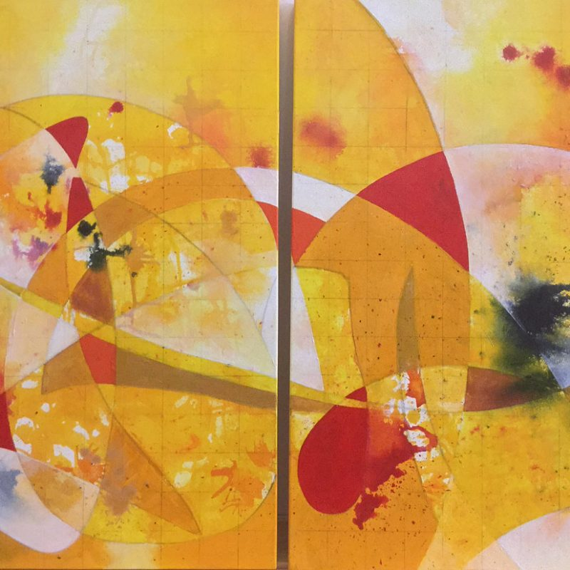 Yellow and red acrylic abstract piece with a dark splashes of ink across the canvas.