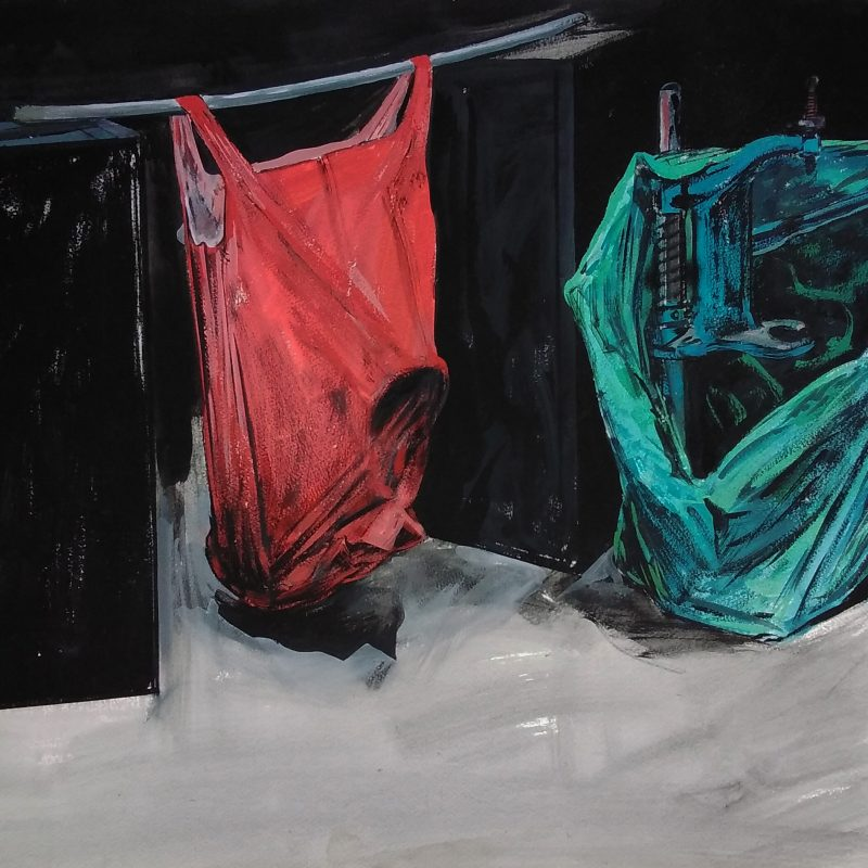 A red carrier bag containing a heavy object is suspended, by it's handles, between two black boxes; in front of one of them is a green carrier bag, shown gaping open to reveal a piece of workshop equipment in bright blue.