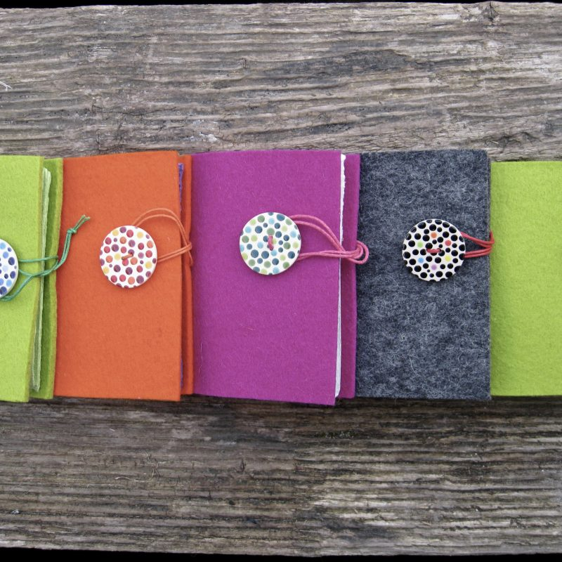 Colourful mini photo albums perfect for small polaroids or your own printed photos