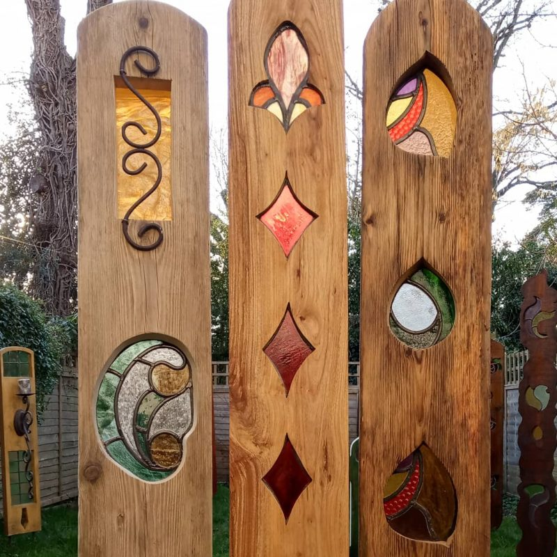 A trio of stained glass garden sculptures. Sweet chestnut and oak. All materials in these three garden designs are reclaimed.. Unique and colourful indoor or outdoor garden designs which have been created from using reclaimed wood and glass. Some designs I have found and up - cycled and added a touch of glass or wood and colour to them