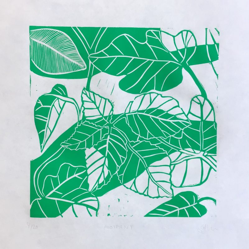 A green and white linocut of overlapping leaves