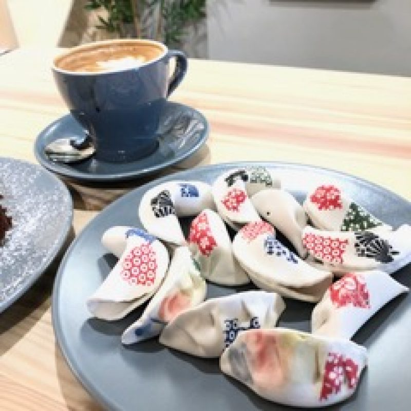 Realistic fortune cookies and dumplings made out of porcelain