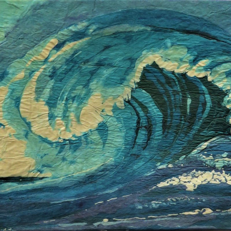 Paper batik of a curling wave in white, turquoises and blues. Mounted not framed