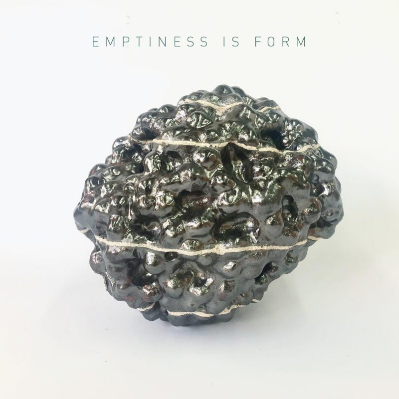 Platinum ceramic form in the shape of a ball with an undulating surface