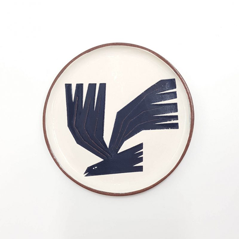 A ceramic plate with a rook on it