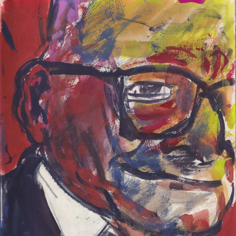 Figure facing the camera side on, dressed in a suit, bowtie and black thick rimmed glasses.