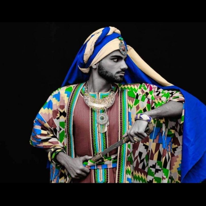 Black and white augmented - A young Prince Aska Mouhammed wearing wax