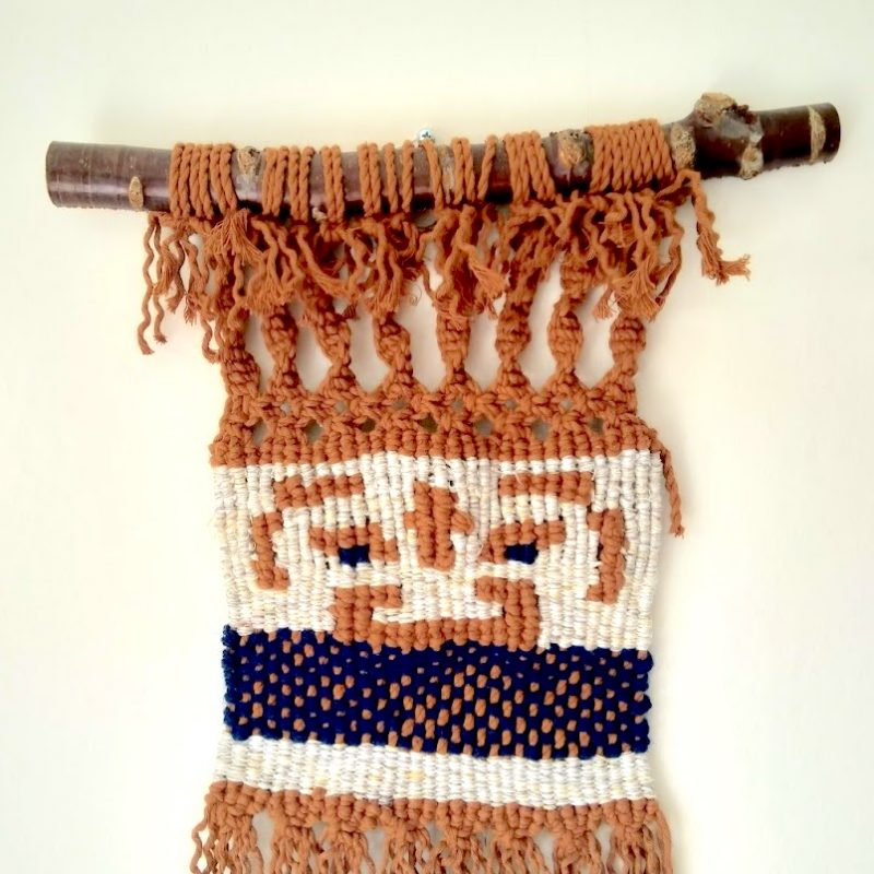 Handwoven ancient Chinese mask image with macrame fringes, mounted on a Tibetan Cherry branch