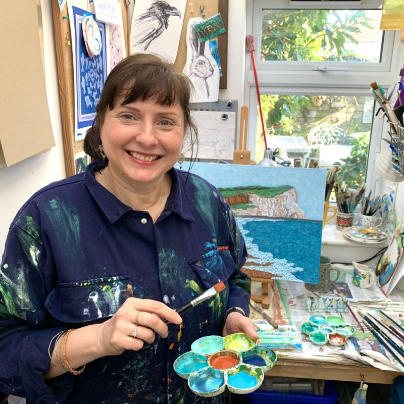 Troy painting in her little glass roofed Brighton studio