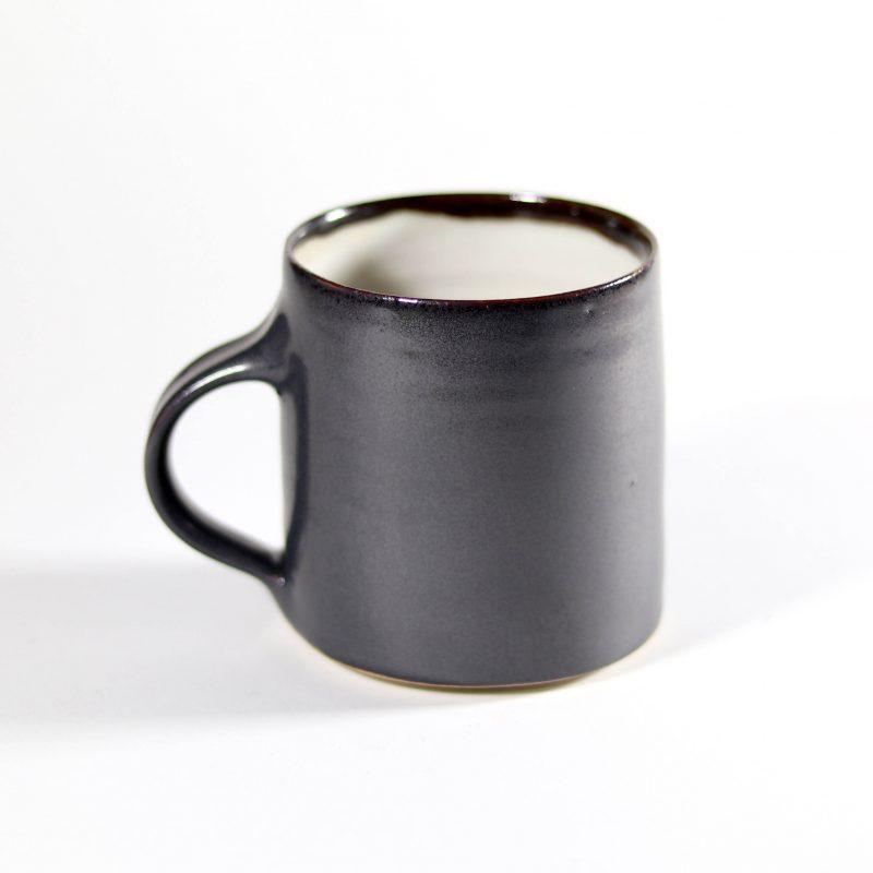 A hand thrown stoneware clay mug