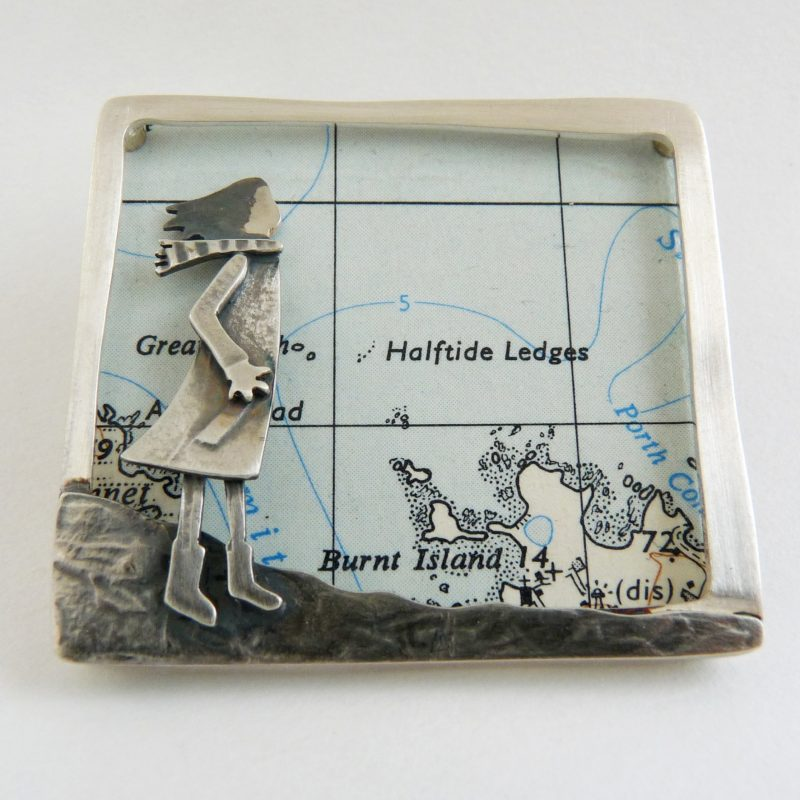 Silver brooch with map insert