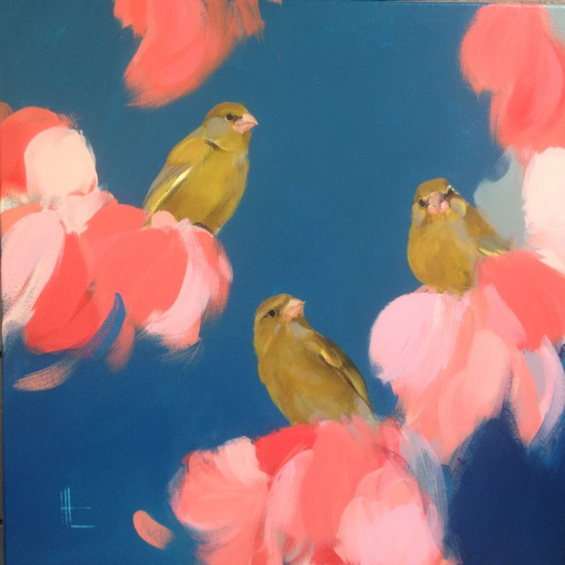 Three greenfinches sit together amongst pink flowers against a royal blue background.
