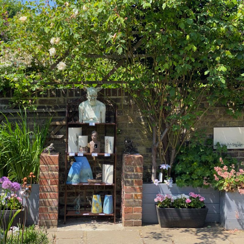 A display of art in the walled garden