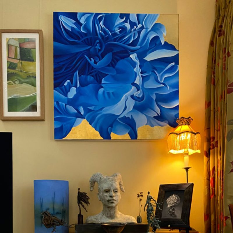 A painting of a peony in blue and a selection of sculptures