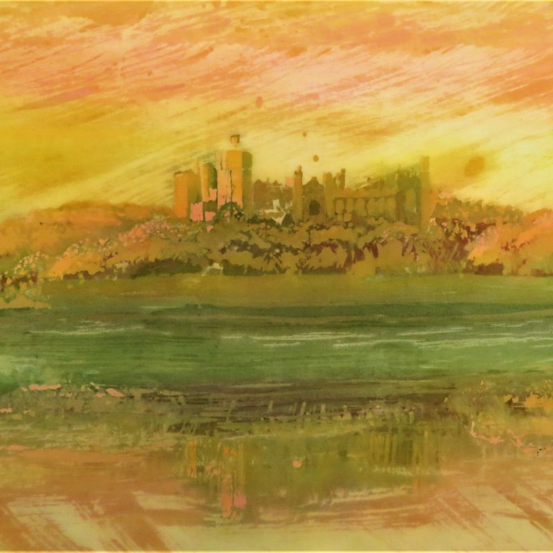 A sunset view of Arundel castle in bright yellows and oranges on cotton.