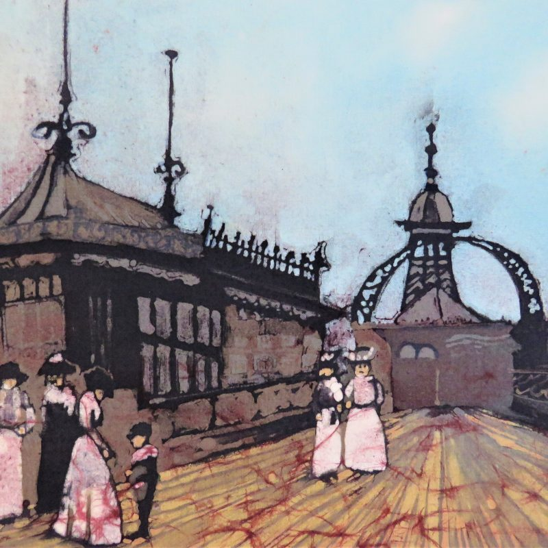 A day out on the pier in Victorian times . People dressed in long dreses strolling along a pier.