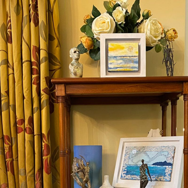 An arrangement of art by the artists at Art in Bloom, including paintings, vases and sculptures